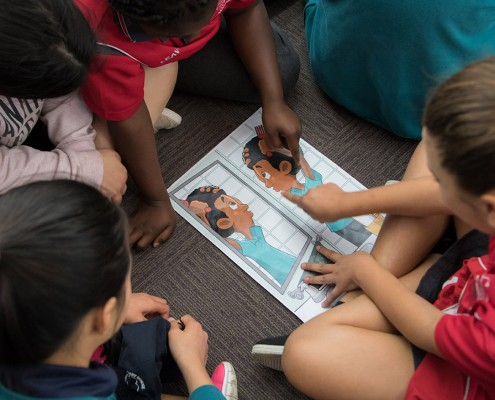 Kids look at our cartoons during Children's Book Week